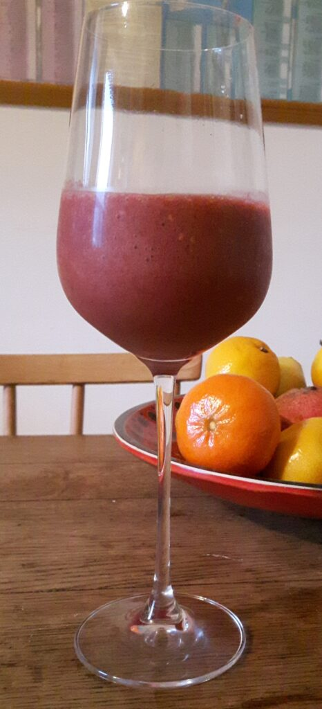A photo of a placenta smoothie in a glass